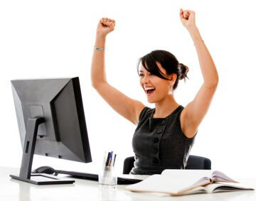 Brunette-Woman-Celebrating-with-Computer